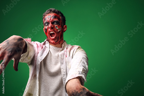 Wallpaper Mural Scary zombie man on color background