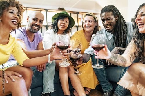Billede på lærred Group of friends having fun at pre dinner party aperitif buffet drinking cocktai