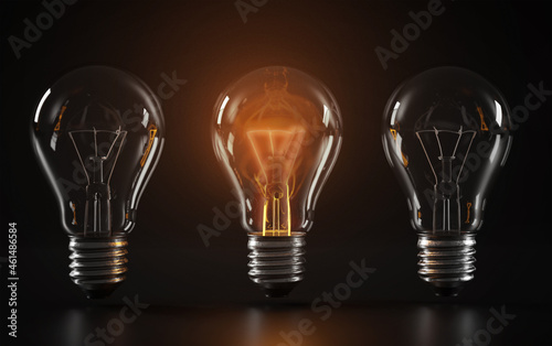 Fotografia A set of Light Bulbs with the One Stands out