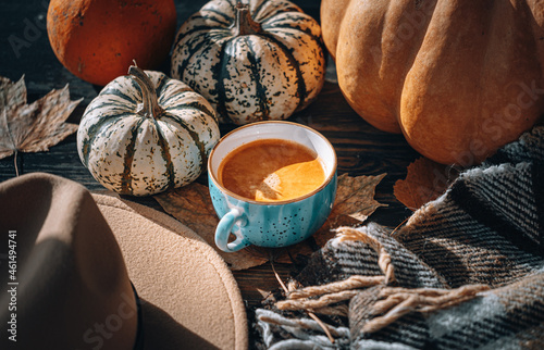 Fotografiet a cup of hot freshly brewed coffee in autumn still life