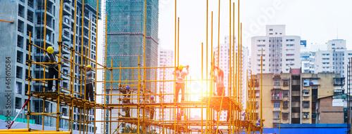 Fotografie, Obraz Construction workers working on scaffolding