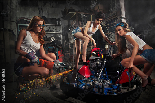 Photo Girls at a garage next to the Go-kart  in smoke
