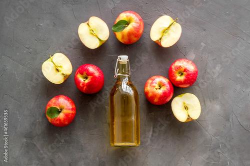 Homemade apple cider vinegar in glass bottle with red apples Fototapet