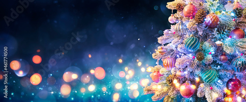 Christmas Tree With Ornaments In Blue Night - Balls On Fir Branches With Defocused Lights In Abstract Background