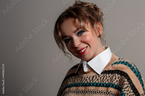 Fototapeta a young beautiful blue-eyed girl in a shirt and jacket
