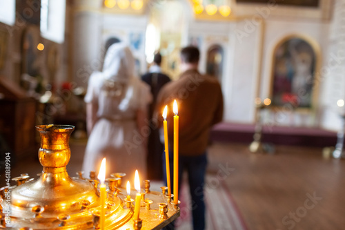 Traditional christening in church with candles Fotobehang