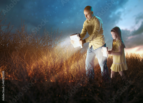 Canvas Print Father and Daugther with glowing Bibles