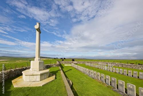 Fotografia, Obraz Cross of sacrifice and headstones at Kilchoman, Islay