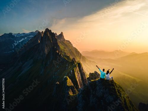 Canvas Print Schaefler Switzerland, a couple walking hiking in mountains during sunset, man a