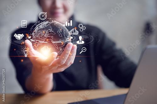 Tela woman Hand holding virtual Global Internet connection metaverse
