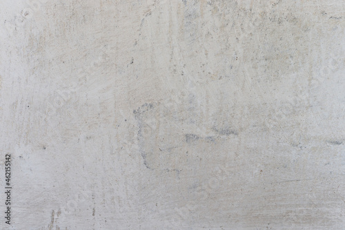 Fototapeta White plaster whitewash wall horizontal background with daubs and fractures