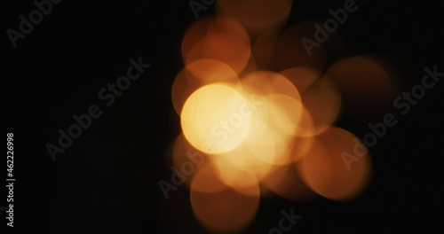Out of focus party sparkler sparkling on black background