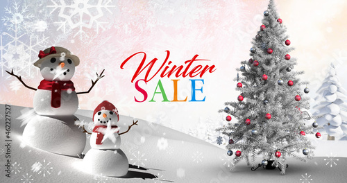 Image of winter sale text over snowman in winter landscape