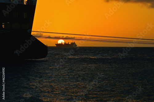 Fototapeta Ships on the Roadstead at the Port of Willemstad, Curacao at Sundown