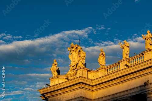 Fotografering A group of Saint Statues on the colonnades of St Peter's Square in Vatican City
