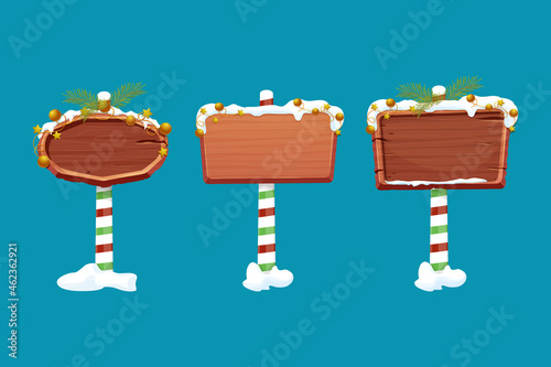 Obraz na plátně Set Christmas wooden signboard, road signs on striped stick with decoration, empty frame in cartoon style isolated on white background