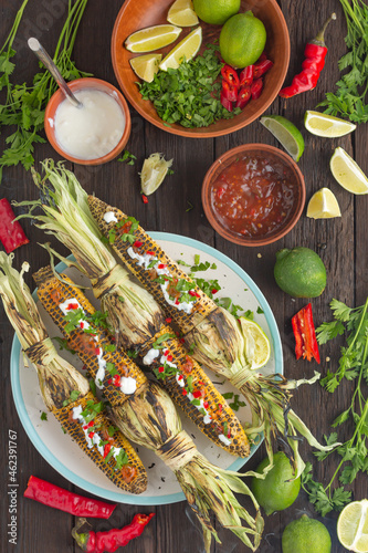 Canvas Print Mexican grilled corn with hot chili sauce