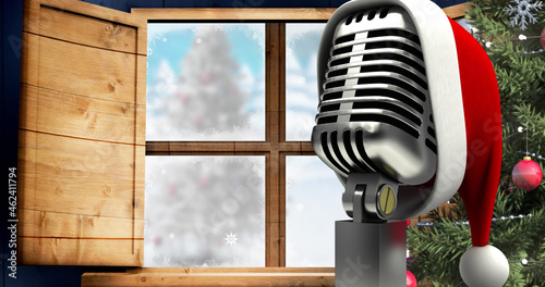 Image of retro microphone over winter landscape