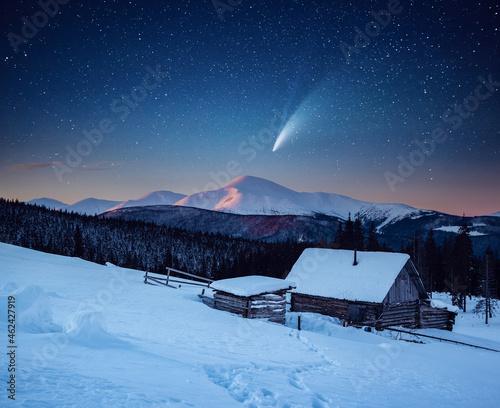 Fotografie, Obraz Frosty winter landscape with wooden hut.