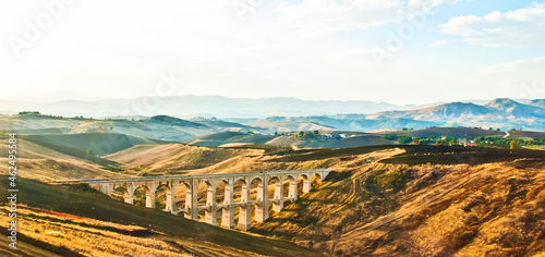 Fotografiet The multiple arches of the aqueduct in Sicily, Italy