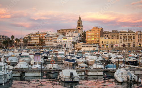 Fotografiet Sunset with the golden sky of the city of Palamós in Girona, Costa Brava