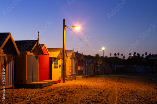 Canvas Brighton beach boxes early morning with a street light