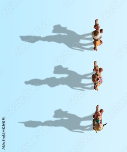 Fényképezés Three Wise Men on camel high view, shadows drawing the Three Wise Men on a blue