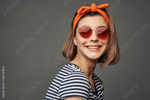 Fotografie, Obraz woman with orange bandage on her head wearing sunglasses posing fashion luxury