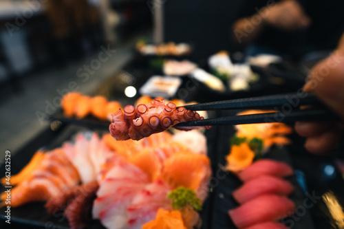 Fototapeta Sashimi and sashimion a plate in a Japanese restaurant