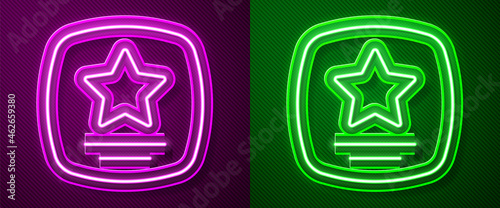 Foto Glowing neon line Walk of fame star on celebrity boulevard icon isolated on purple and green background