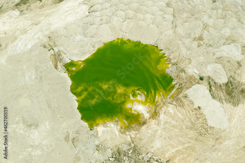 Fototapeta Green lake formed at the site of a sand pit