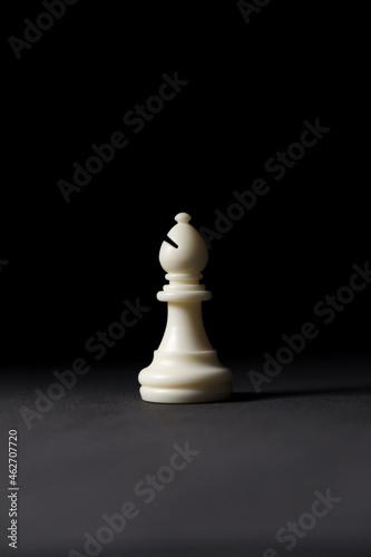 Billede på lærred isolated white bishop chess piece on black background.