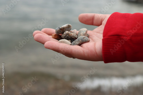 Tela he holds sea stones in his hand