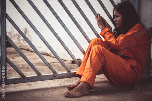 Obraz na plátně Portrait of women desperate to catch the iron prison,prisoner concept,thailand people,Hope to be free,If the violate the law would be arrested and jailed