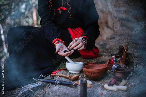 Canvastavla A witch in a black long dress of Slavic style is holding a magic rite in the mountains