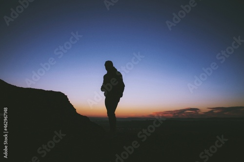 Obraz na plátně silhouette of a person in the mountains