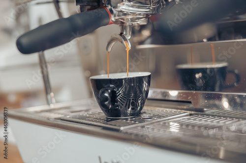 Tableau sur Toile Professional espresso machine brewing coffee in coffee shop