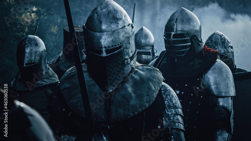 Fotografering Epic Invading Army of Medieval Soldiers Marching on Battlefield, Armored Warriors with Swords