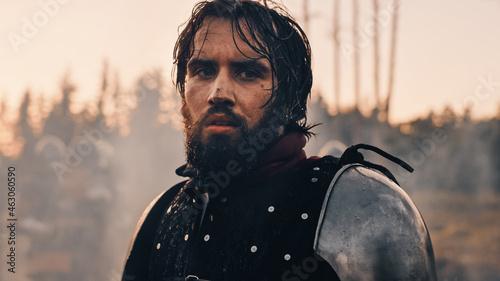 Obraz na plátně Handsome Medieval Knight King on Battlefield, Looking at Camera