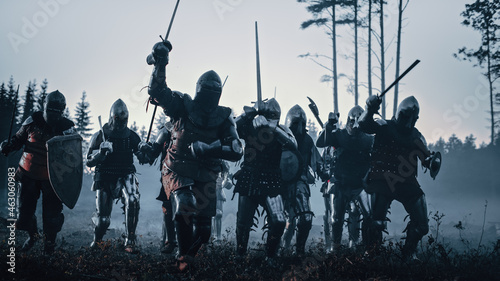 Fotografie, Obraz Epic Battle: Army of Medieval Knights on Battlefield, Scream Battle Cry and Charge with Attack on the Enemy
