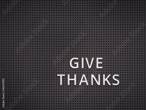 Fotografie, Obraz Words Give Thanks spelled out with white letters on gray pegboard
