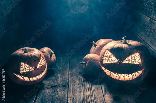Canvas Creepy and strange Jack-o-lantern in wooden shack.