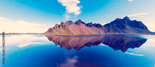 beautiful landscape with most breathtaking mountains Vestrahorn on the Stokksnes peninsula in the mirror of the lake. Exotic countries. Amazing places. (Meditation, antistress - concept).