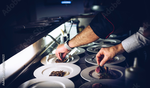 Tela Chef and sous chef prepare gourmet meals in the kitchen.
