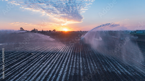 Photo Water sprinklers on a ploughed field near Gin Gin, Queensland
