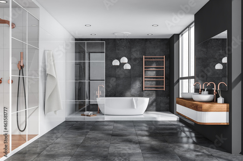 Photographie Grey bathroom with tiled floor and walls