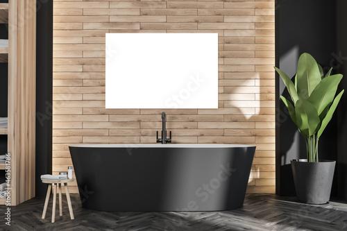 Poster with oval black bathtub in modern wood look bathroom