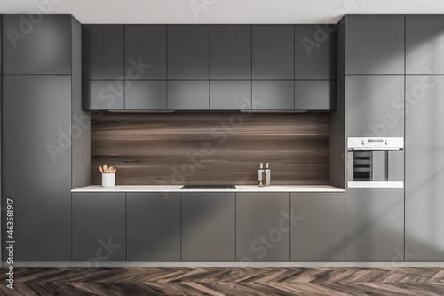 Simple grey kitchen with dark wood backsplash