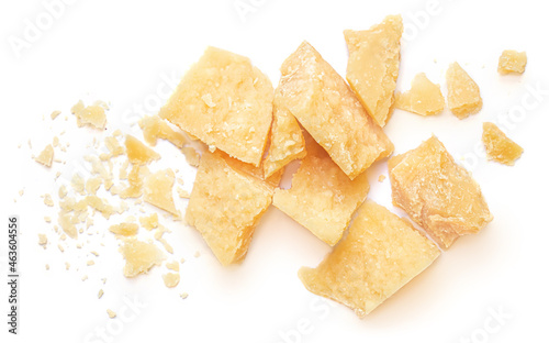 Pieces of parmesan cheese isolated on white background. Parmesan chunks with crumbs  top view