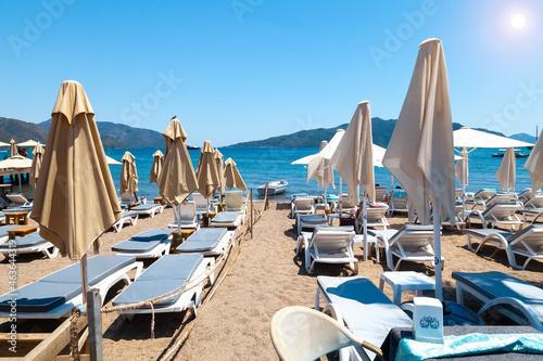 Fototapeta Sea view and beach loungers